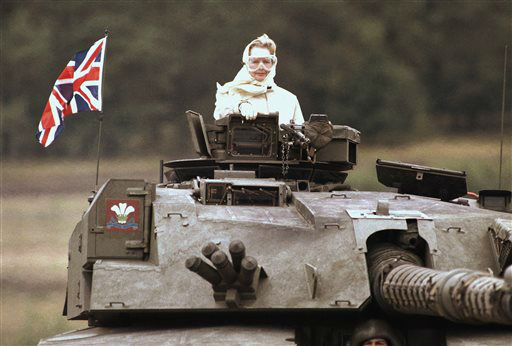 British Prime Minister Margaret Thatcher stands in a British tank during a visit to British forces in Fallingbostel, some 120km &#40;70 miles&#41; south of Hamburg, Germany. on Sept. 17, 1986. Thatchers former spokesman, Tim Bell, said that the former British Prime Minister Margaret Thatcher had died Monday morning, April 8, 2013, of a stroke. She was 87.&#40;AP Photo&#47;Jockel Fink&#41; <span class=meta>(AP Photo&#47; Jockel Fink)</span>