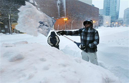 "<div class=""meta ""><span class=""caption-text "">Andrew Laliberte, of Billerica, Mass., digs a pathway through a high snow drift in Boston, Saturday, Feb. 9, 2013. The Boston area received about two feet of snow from a winter storm. (AP Photo/Charles Krupa) (AP Photo/ Charles Krupa)</span></div>"