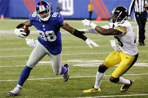 New York Giants wide receiver Hakeem Nicks &#40;88&#41; runs away from Pittsburgh Steelers cornerback Keenan Lewis &#40;23&#41; during the second half of an NFL football game, Sunday, Nov. 4, 2012, in East Rutherford, N.J. &#40;AP Photo&#47;Bill Kostroun&#41; <span class=meta>(AP Photo&#47; Bill Kostroun)</span>