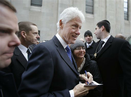 Former President of the United States Bill Clinton talks with supporters and signs autographs after the funeral of former New York City Mayor Ed Koch in New York, Monday, Feb. 4, 2013. Koch was remembered as the quintessential New Yorker during a funeral that frequently elicited laughter, recalling his famous one-liners and amusing antics in the public eye. Koch died Friday of congestive heart failure at age 88. &#40;AP Photo&#47;Seth Wenig&#41; <span class=meta>(AP Photo&#47; Seth Wenig)</span>