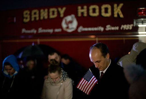 Mourners listen to a memorial service over a loudspeaker outside Newtown High School for the victims of the Sandy Hook Elementary School shooting, Sunday, Dec. 16, 2012, in Newtown, Conn. &#40;AP Photo&#47;David Goldman&#41; <span class=meta>(AP Photo&#47; David Goldman)</span>