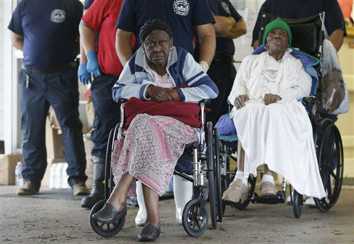"<div class=""meta ""><span class=""caption-text "">Residents of the Riverbend Nursing Center wait to be evacuated to higher and safer ground as Hurricane Isaac makes landfall, Wednesday, Aug. 29, 2012, in Jesuit Bend, La. Plaquemines Parish ordered a mandatory evacuation for the west bank of the Mississippi below Belle Chasse because of worries about a storm surge. The order affected about 3,000 people, including residents of the nursing home. (AP Photo/Eric Gay) (AP Photo/ Eric Gay)</span></div>"