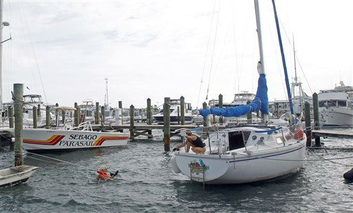 Craig Jones, left, and Kimberly Branson secure their boat in Key West, Fla., Sunday, Aug. 26, 2012 in preparation for Tropical Storm Isaac. Tropical Storm Isaac gained fresh muscle Sunday as it bore down on the Florida Keys, with forecasters warning it could grow into a dangerous Category 2 hurricane as it nears the northern Gulf Coast. &#40;AP Photo&#47;Alan Diaz&#41; <span class=meta>(AP Photo&#47; Alan Diaz)</span>