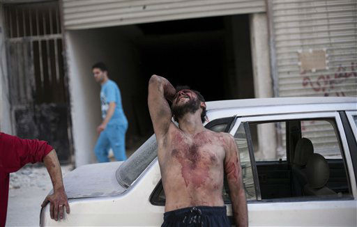 A Syrian man cries outside the Dar El Shifa hospital in Aleppo, Syria after his daughter was injured during a Syrian Air Force strike over a school where hundreds of refugees had taken shelter Thursday, Oct. 4, 2012. The border violence between Turkey and Syria has added a dangerous new dimension to Syria&#39;s civil war, dragging Syria&#39;s neighbors deeper into a conflict that activists say has already killed 30,000 people since an uprising against President Bashar Assad&#39;s regime began in March 2011. &#40;AP Photo&#47; Manu Brabo&#41; <span class=meta>(AP Photo&#47; Manu Brabo)</span>