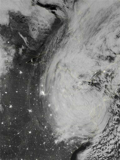 "<div class=""meta image-caption""><div class=""origin-logo origin-image ""><span></span></div><span class=""caption-text"">This image provided by NASA shows the eastern seaboard of the United States of America at night from a composite assembled from data acquired by the Suomi NPP satellite as Hurricane Sandy came ashore on Oct. 30, 2012. The Visible Infrared Imaging Radiometer Suite (VIIRS) on the Suomi NPP satellite acquired this image of hurricane Sandy at 3:35 a.m. EDT. This image is from the ""day-night band"" on VIIRS, which detects light wavelengths from green to near-infrared. The full Moon, which exacerbated the height of the storm water surge, lit the tops of the clouds. Sandy's clouds stretched from the Atlantic Ocean to Chicago. Clusters of lights gave away the locations of some cities throughout the region; but along the East Coast, clouds obscured the lights, many of which were blacked out due to the storm. Several million customers over multiple states were without electricity. (AP Photo/NASA) (AP Photo/ Uncredited)</span></div>"