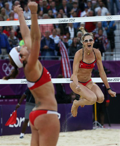 "<div class=""meta ""><span class=""caption-text "">United States' Misty May-Treanor, left, and Kerri Walsh Jennings celebrate after defeating China in their semifinal women's beach volleyball match at the 2012 Summer Olympics, Tuesday, Aug. 7, 2012, in London. (AP Photo/Petr David Josek) (AP Photo/ Petr David Josek)</span></div>"