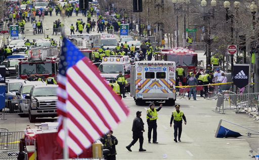 "<div class=""meta ""><span class=""caption-text "">Emergency workers aid injured people at the finish line of the 2013 Boston Marathon following an explosion in Boston, Monday, April 15, 2013. (AP Photo/Charles Krupa) (AP Photo/ Charles Krupa)</span></div>"