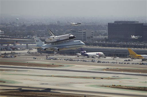 In this photo provided by NASA, the Space Shuttle Endeavour atop a modified 747 lands at Los Angeles International Airport on Friday, Sept. 21, 2012 in Los Angeles. Endeavour will be permanently displayed at the California Science Center in Los Angeles. (AP Photo/NASA, Joel Kowsky)