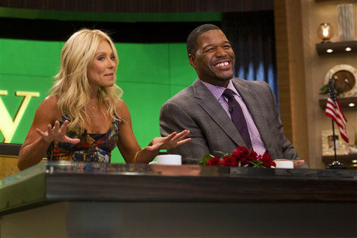 "<div class=""meta image-caption""><div class=""origin-logo origin-image ""><span></span></div><span class=""caption-text"">Michael Strahan joins Kelly Ripa as the new co-host of ""Live! with Kelly and Michael"" on Tuesday, Sept. 4, 2012 in New York. (Photo by Charles Sykes/Invision/AP Images) (Photo/Charles Sykes)</span></div>"