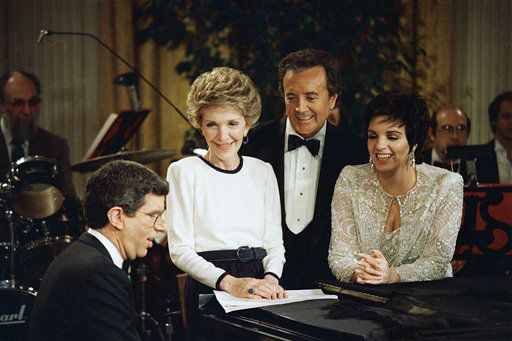 First Lady Nancy Reagan sings a song along with Marvin Hamlisch, left, Vic Damone, center and Liza Minnelli during a rehearsal at the White House on Sunday, March 8, 1987 in Washington for the second performance of this season&#39;s &#34;sIn Performance at the White House&#34;  telecasts.   The performance which was taped in the East Room will air on PBS television stations March 25 at 8.00 PM EST. &#40;AP Photo&#47;Charles Tasnadi&#41; <span class=meta>(AP Photo&#47; Chrales Tasnadi)</span>