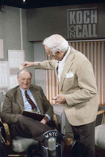 New York Mayor Ed Koch gets his head powered by a make-up artist before the start of his new television call-in program, &#34;Koch on Call&#34; on Sunday, March 15, 1987 at New York&#39;s Channel 5.    Koch, who will not be paid in exchange for the airing of public service announcements, said he wants his program to reflect the human side of his guests.  &#40;AP Photo&#47;David Bookstaver&#41; <span class=meta>(AP Photo&#47; David Bookstaver)</span>
