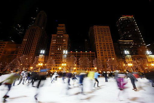 People skate on an ice rink in Chicago, Sunday, Dec. 30, 2012. Snow and cold have been lacking in Chicago recently and one of the city's winterless weather streaks has now tied an all-time record. (AP Photo/Nam Y. Huh)