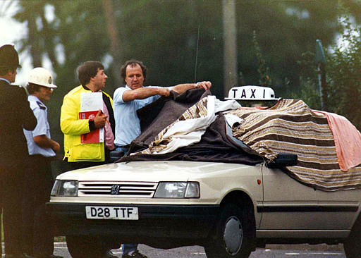 "<div class=""meta image-caption""><div class=""origin-logo origin-image ""><span></span></div><span class=""caption-text"">Blankets cover the windows of a taxi in Hungerford, 60 miles west of London, Aug. 19, 1987, containing the body of one of the victims of gunman Michael Ryan, who opened fire in the town, killing 14 people. Ryan killed himself with a pistol after being surrounded by police.  (AP Photo/Dave Caulkin) (AP Photo/ Dave Caulkin)</span></div>"