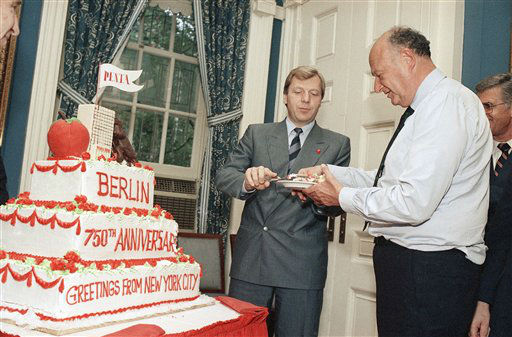 Mayor Edward Koch, right, accepts a slice of cake from West Berlin Mayor Eberhard Diepgen at City Hall on Friday, Sept. 18, 1987 in New York.    The two mayors celebrated the 750th Anniversary of Berlin with a giant cake proclaiming &#34;Greetings from New York City.&#34;  &#40;AP Photo&#47;Marty Lederhandler&#41; <span class=meta>(AP Photo&#47; Marty Lederhandler)</span>
