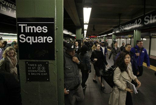 Passengers exit a downtown-bound, west side subway train in New York&#39;s Times Square,  Thursday, Nov. 1, 2012.  New York City moved closer to resuming its frenetic pace by getting back its vital subways Thursday, three days after a superstorm, but neighboring New Jersey was stunned by miles of coastal devastation and the news of thousands of people in one city still stranded by increasingly fetid flood waters.  &#40;AP Photo&#47;Richard Drew&#41; <span class=meta>(AP Photo&#47; Richard Drew)</span>