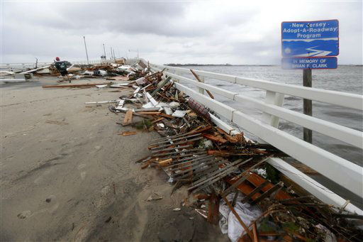 "<div class=""meta ""><span class=""caption-text "">Floodwaters surround homes near the Mantoloking Bridge the morning after hybrid storm Sandy rolled through, Tuesday, Oct. 30, 2012, in Mantoloking, N.J. Sandy, which was downgraded from a Hurricane just before making landfall in New Jersey, left millions without power. (AP Photo/Julio Cortez) (AP Photo/ Julio Cortez)</span></div>"