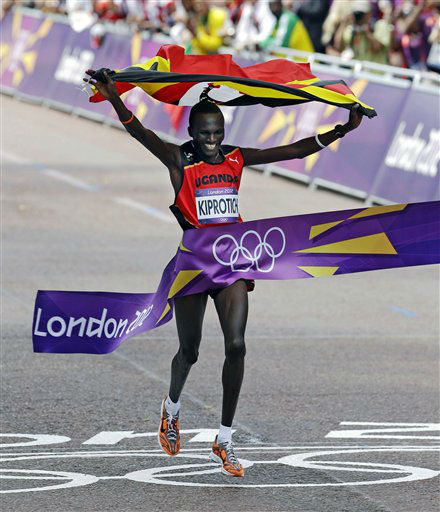 "<div class=""meta ""><span class=""caption-text "">Gold-medalist Stephen Kiprotich of Uganda finishes the men's marathon at the 2012 Summer Olympics, Sunday, Aug. 12, 2012, in London. (AP Photo/Mike Groll) (AP Photo/ Mike Groll)</span></div>"