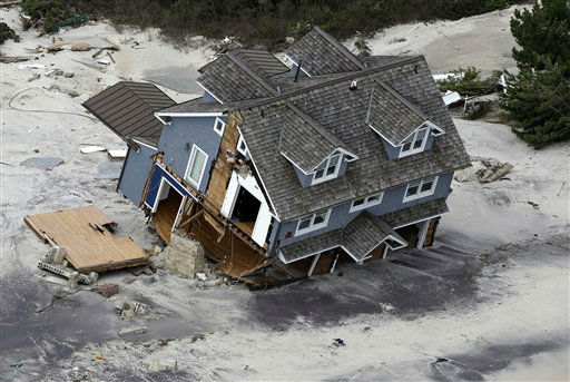 This aerial photo shows a collapsed house along the central Jersey Shore coast on Wednesday, Oct. 31, 2012. New Jersey got the brunt of Sandy, which made landfall in the state and killed six people. More than 2 million customers were without power as of Wednesday afternoon, down from a peak of 2.7 million. &#40;AP Photo&#47;Mike Groll&#41; <span class=meta>(AP Photo&#47; Mike Groll)</span>