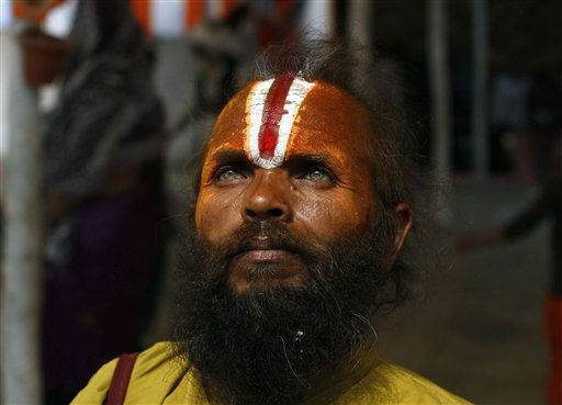 "<div class=""meta image-caption""><div class=""origin-logo origin-image ""><span></span></div><span class=""caption-text"">A Hindu holy man pauses as he returns after taking part in a community feast at the Ashram of Swami Ramanand Das at Sangam, the confluence of the Ganges and Yamuna River during the Maha Kumbh festival, in Allahabad, India, Wednesday, Feb. 20, 2013. Millions of Hindu pilgrims have been attending the Maha Kumbh festival, which is one of the world's largest religious gatherings that lasts 55 days and falls every 12 years. (AP Photo/ Rajesh Kumar Singh)</span></div>"