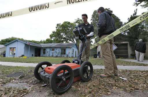 "<div class=""meta ""><span class=""caption-text "">CORRECTS REFERENCE TO CONTACT -  Engineers work in front of a home where sinkhole opened up underneath a bedroom and swallowed a man Friday, March 1, 2013, in Seffner, Fla.  Jeff Bush screamed for help and disappeared as a large sinkhole opened under the bedroom of his house, his brother said Friday. Jeremy Bush told rescue crews he heard a loud crash near midnight Thursday, then heard his brother screaming.  There's been no contact with Jeff Bush since then, and neighbors on both sides of the home have been evacuated. (AP Photo/Chris O'Meara) (AP Photo/ Chris O'Meara)</span></div>"