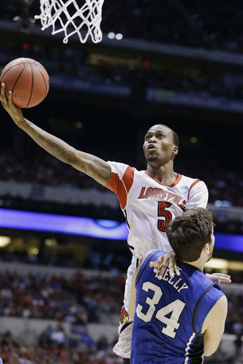 "<div class=""meta ""><span class=""caption-text "">Louisville guard Kevin Ware (5) goes up up with a shot against Duke forward Ryan Kelly (34) during the first half of the Midwest Regional final in the NCAA college basketball tournament, Sunday, March 31, 2013, in Indianapolis. (AP Photo/Michael Conroy) (AP Photo/ Michael Conroy)</span></div>"