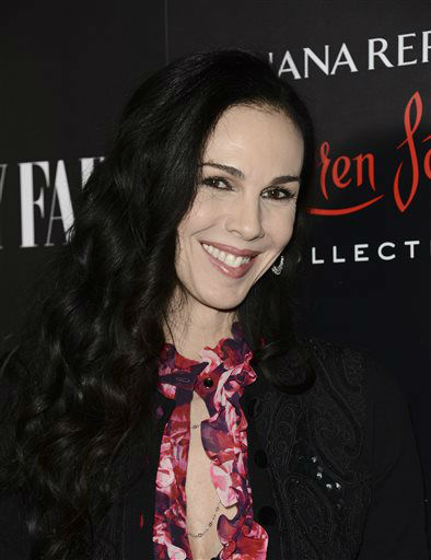 Fashion designer L&#39;Wren Scott arrives at the Banana Republic L&#39;Wren Scott Collection launch party at the Chateau Marmont on Tuesday, Nov. 19, 2013 in West Hollywood, Calif. &#40;Photo by Dan Steinberg&#47;Invision&#47;AP&#41; <span class=meta>(Photo&#47;Dan Steinberg)</span>