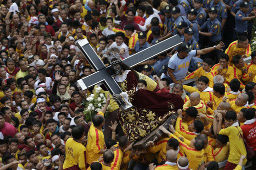 "<div class=""meta ""><span class=""caption-text "">Catholic devotees jostle to get closer to the centuries-old image of the Black Nazarene in a raucous celebration on its feast day Wednesday, Jan. 9, 2013 in Manila, Philippines. The annual procession by hundreds of thousands of devotees is now becoming to be a tourist attraction. (AP Photo/Bullit Marquez) (AP Photo/ Bullit Marquez)</span></div>"