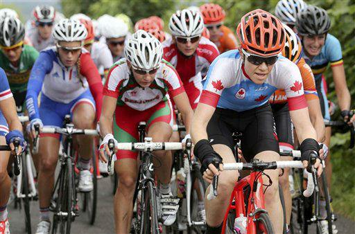 Canada&#39;s Clara Hughes, right,  leads the pack during the women&#39;s cycling road race final at the 2012 Summer Olympics on Sunday, July 29, 2012, in London. &#40;AP Photo&#47;Stefano Rellandini, Pool&#41; <span class=meta>(AP Photo&#47; Stefano Rellandini)</span>