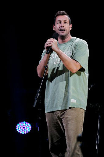 "<div class=""meta image-caption""><div class=""origin-logo origin-image ""><span></span></div><span class=""caption-text"">This image released by Starpix shows Adam Sandler performing at the 12-12-12 The Concert for Sandy Relief at Madison Square Garden in New York on Wednesday, Dec. 12, 2012. Proceeds from the show will be distributed through the Robin Hood Foundation. (AP Photo/Starpix, Dave Allocca) (AP Photo/ Dave Allocca)</span></div>"