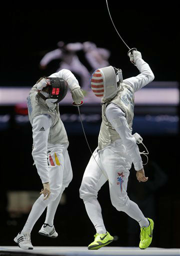 Benjamin Kleibrink of Germany competes against Gerek Meinhardt of the United States, right, in the bronze medal match during the men&#39;s foil team fencing competition at the 2012 Summer Olympics, Sunday, Aug. 5, 2012, in London. &#40;AP Photo&#47;Dmitry Lovetsky&#41; <span class=meta>(AP Photo&#47; Dmitry Lovetsky)</span>