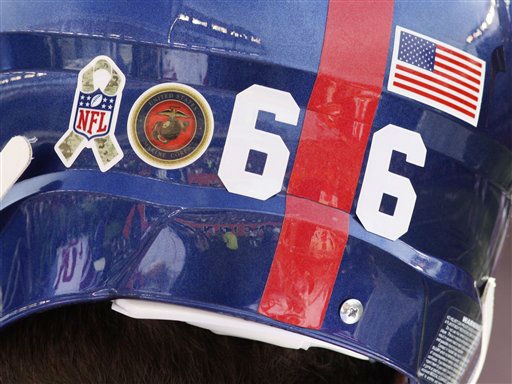 New York Giants tackle David Diehl wears military sticke rs on his helmet in the second half of an NFL football game against the Cincinnati Bengals, Sunday, Nov. 11, 2012, in Cincinnati. &#40;AP Photo&#47;Tom Uhlman&#41; <span class=meta>(AP Photo&#47; Tom Uhlman)</span>