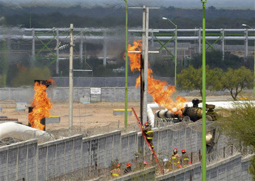 "<div class=""meta ""><span class=""caption-text "">Firefighter climb a ladder as they try to control a fire after an explosion at a gas pipeline distribution center in Reynosa, Mexico near Mexico's border with the United States, Tuesday Sept. 18, 2012. Mexico's state-owned oil company, Petroleos Mexicanos, also known as Pemex said the fire had been extinguished and the pipeline had been shut off but at least 26 people were killed during the incident. (AP Photo/El Manana de Reynosa) (AP Photo/ El Manana de Reynosa)</span></div>"