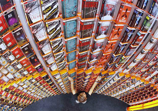 "<div class=""meta ""><span class=""caption-text "">A women arranges books on a shelf at the Frankfurt Book Fair that will be opened later in the day  in Frankfurt, Germany, Tuesday, Oct. 9, 2012. New Zealand is this year's  guest of honor at the book fair. (AP Photo/Michael Probst) (AP Photo/ Michael Probst)</span></div>"