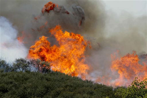 "<div class=""meta ""><span class=""caption-text "">Smoke and fire billows over a hill near Thousand Oaks, Calif. on Thursday, May 2, 2013. Authorities have ordered evacuations of a neighborhood and a university about 50 miles west of Los Angeles where a wildfire is raging close to subdivisions.  (AP Photo/Nick Ut) (AP Photo/ Nick Ut)</span></div>"