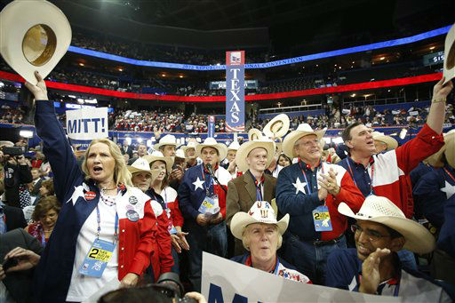 "<div class=""meta image-caption""><div class=""origin-logo origin-image ""><span></span></div><span class=""caption-text"">Texas delegates cheer as Mitt Romney is nominated for the Office of the President of the United States at the Republican National Convention in Tampa, Fla., on Tuesday, Aug. 28, 2012. (AP Photo/Jae C. Hong) (AP Photo/ Jae C. Hong)</span></div>"