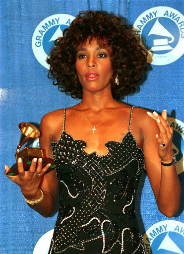 FILE - In this March 3, 1988, file photo, Whitney Houston poses with her Grammy at the annual Grammy Awards presentation in New York. Publicist Kristen Foster said, Saturday, Feb. 11, 2012, that singer Whitney Houston has died at age 48.    &#40;AP Photo&#47;Mark Lennihan, File&#41; <span class=meta>(AP Photo&#47; MARK LENNIHAN)</span>