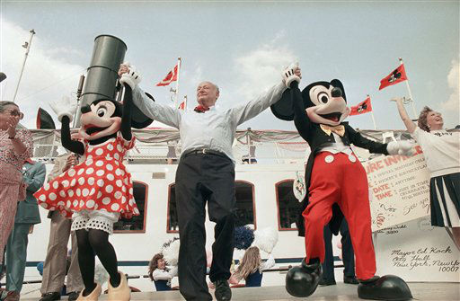 New York Edward I. Koch, center, helps Minnie Mouse, left, and Mickey Mouse celebrate Mickey&#39;s 60th anniversary, on Wednesday, August 10, 1988 in New York&#39;s South Street Seaport.   The planned launch of 4,000 balloons went ahead as scheduled, even though a marine specialist says he sent Koch a telegram saying that balloon launches could hurt sea creatures. &#40;AP Photo&#47;Marty Lederhandler&#41; <span class=meta>(AP Photo&#47; Marty Lederhandler)</span>