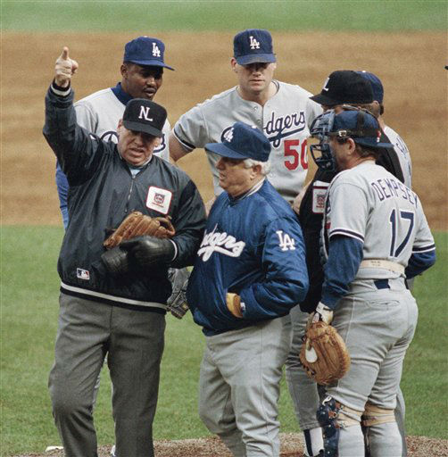 FILE - In this Oct. 8, 1988 file photo, umpire crew chief Harry Wendelstedt, left, signals the ejection of Los Angeles Dodgers pitcher Jay Howell, right rear, after a possible illegal substance was found in Howell&#39;s glove in the eighth inning of  a playoff game, in New York. Dodgers manager Tom Lasorda, foreground center, talks to Wendelstedt. The rest of the players are unidentified. Wendelstedt has died after an extended illness. He was 73. Major League Baseball said Wendelstedt died Friday, March 9, 2012 in Ormond Beach, Fla. He had been diagnosed several years ago with a brain tumor. &#40;AP Photo&#47;Bill Kostroun, FIle&#41; <span class=meta>(AP Photo&#47; Bill Kostroun)</span>