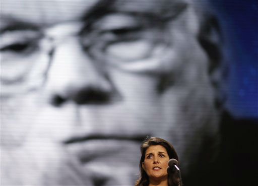"<div class=""meta ""><span class=""caption-text "">South Carolina Gov. Nikki Haley stands behind the podium for a test in front of a picture display of Neil Armstrong, the first man to walk on the moon, in the Tampa Bay Times Forum at the Republican National Convention in Tampa, Fla., on Sunday, Aug. 26, 2012. Armstrong died Saturday. (AP Photo/David Goldman) (AP Photo/ David Goldman)</span></div>"
