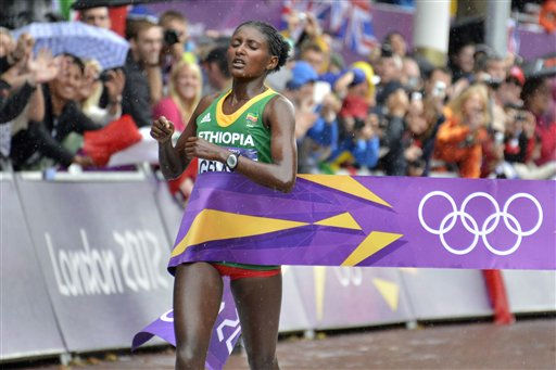 Ethiopia&#39;s Tiki Gelana crosses the finish lline to win gold in the women&#39;s marathon at the 2012 Summer Olympics on, Sunday, Aug. 5, 2012 in London. &#40;AP Photo&#47;Martin Meissner&#41; <span class=meta>(AP Photo&#47; Martin Meissner)</span>