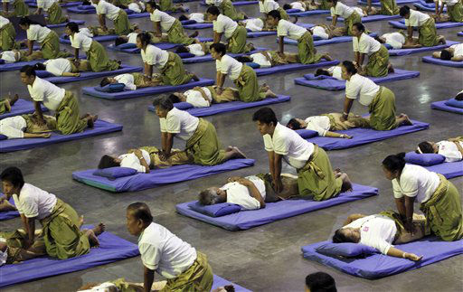 "<div class=""meta image-caption""><div class=""origin-logo origin-image ""><span></span></div><span class=""caption-text"">Thai masseuses perform mass massaging at a sport arena on the outskirts of Bangkok, Thailand Thursday, Aug. 30, 2012. Thailand has long been known as the massage capital of the world. Now, it has a Guinness World Record to prove it when some 641 massage therapists mass-massaged 641 people simultaneously for 12 minutes to win the honor Thursday at an indoor arena in Bangkok. The event was organized by the Health Ministry to promote the Southeast Asian nation's massage and spa industry. (AP Photo/Apichart Weerawong) (AP Photo/ Apichart Weerawong)</span></div>"