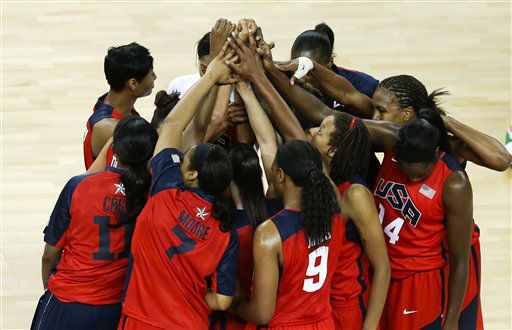 The United States team gathers at half court after beating Australia in a women&#39;s basketball semifinal game at the 2012 Summer Olympics, Thursday, Aug. 9, 2012, in London. &#40;AP Photo&#47;Victor R. Caivano&#41; <span class=meta>(AP Photo&#47; Victor R. Caivano)</span>