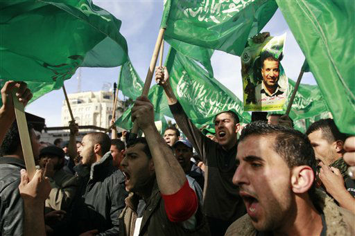 Palestinian Hamas supporters march in support of the people of the Gaza Strip and against Israel&#39;s military operations, in the West Bank city of Ramallah, Friday, Nov. 16, 2012. &#40;AP Photo&#47;Majdi Mohammed&#41; <span class=meta>(AP Photo&#47; Majdi Mohammed)</span>