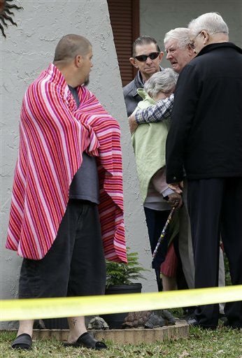 "<div class=""meta ""><span class=""caption-text "">Family members console each other near the home where Jeff Bush disappeared as a large sinkhole opened under the bedroom of his house on  Friday, March 1, 2013, in Seffner, Fla.  Jeremy Bush told rescue crews he heard a loud crash near midnight Thursday, then heard his brother screaming.  There's been no contact with Jeremy Bush since then, and neighbors on both sides of the home have been evacuated. (AP Photo/Chris O'Meara) (AP Photo/ Chris O'Meara)</span></div>"
