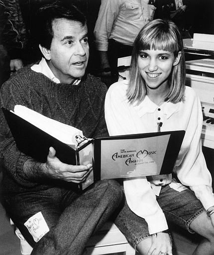 Executive producer Dick Clark and teen singing star Debbie Gibson go over the script for the 16th annual telecast of the &#34;American Music Awards&#34; during rehearsals at Los Angeles&#39; Shrine Auditorium Friday night,  January 28, 1989. Gibson will co-host the show with Anita Baker, Kenny Rogers and Rod Stewart when the show airs Monday night, Jan. 30. &#40;AP Photo&#47;ho&#41; <span class=meta>(AP Photo&#47; Anonymous)</span>