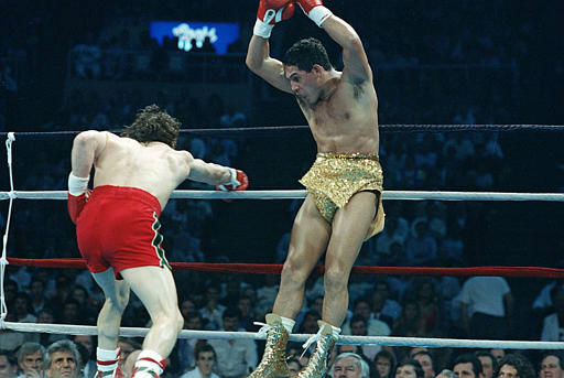 "<div class=""meta ""><span class=""caption-text "">Hector Camacho, right, jumps out of the way of a punch thrown by Ray Mancini during the third round of their WBO Junior Welterweight Title fight in Reno, Nevada, March 7, 1989. Camacho won on a split decision. (AP Photo/Staff/Risberg) (AP Photo/ ERIC RISBERG)</span></div>"