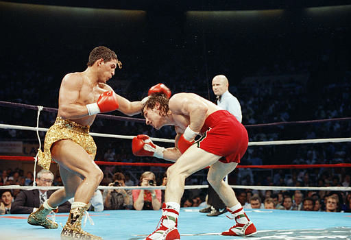 Hector Camacho, left, throws a punch at Ray &#34;Boom Boom&#34; Mancini during their WBO Junior Welterweight Title fight in Reno, Nevada, March 7, 1989. Camacho won on a split decision. &#40;AP Photo&#47;Staff&#47;Risberg&#41; <span class=meta>(AP Photo&#47; ERIC RISBERG)</span>