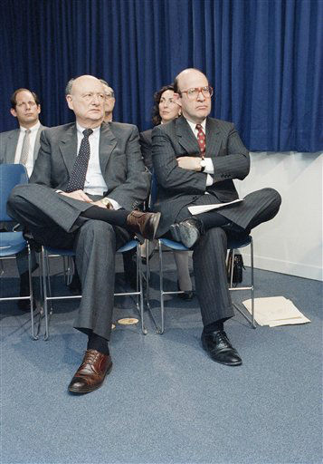 With legs crossed towards each other, New York Mayor Edward I. Koch and State Attorney General Robert Abrams listen to a speech by Governor Mario Cuomo at New York&#39;s World Trade Center on Thursday, March 24, 1989.   Cuomo announced a plan to combat illegal drugs, including a sweeping new law to strengthen the state&#39;s forfeiture law for ill-gotten drug proceeds. &#40;AP Photo&#47;Marry Lederhandler&#41; <span class=meta>(AP Photo&#47; Marry Lederhandler)</span>