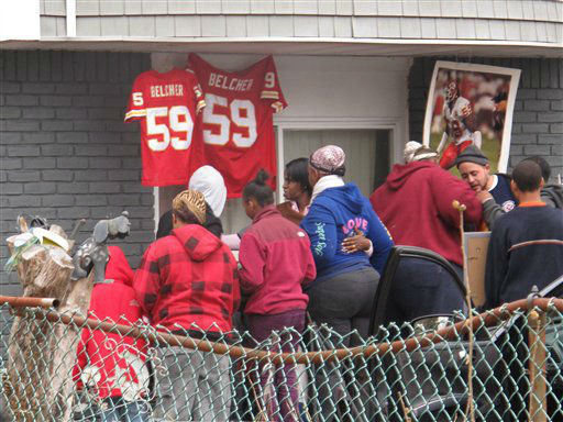 Friends and relatives of Kansas City Chiefs linebacker Jovan Belcher grieve outside the player&#39;s home on Dec. 1, 2012, in West Babylon, N.Y. Police said the Long Island native shot and killed his girlfriend before taking his own life on Saturday in Kansas City. &#40;AP Photo&#47;Frank Eltman&#41; <span class=meta>(AP Photo&#47; Frank Eltman)</span>