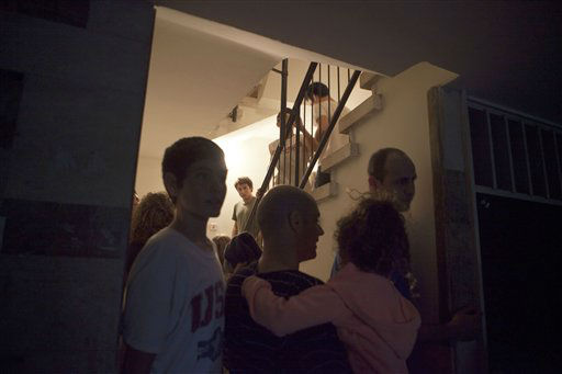 "<div class=""meta image-caption""><div class=""origin-logo origin-image ""><span></span></div><span class=""caption-text"">Israelis take cover inside a shelter during a siren alert for a rocket  fired by Palestinian militants from the Gaza Strip, at a hospital in Tel Aviv, Israel, Saturday, Nov. 17, 2012. Israel bombarded the Hamas-ruled Gaza Strip with nearly 200 airstrikes early Saturday, the military said, widening a blistering assault on Gaza rocket operations to include the prime minister's headquarters, a police compound and a vast network of smuggling tunnels. (AP Photo/Dan Balilty) (AP Photo/ Dan Balilty)</span></div>"